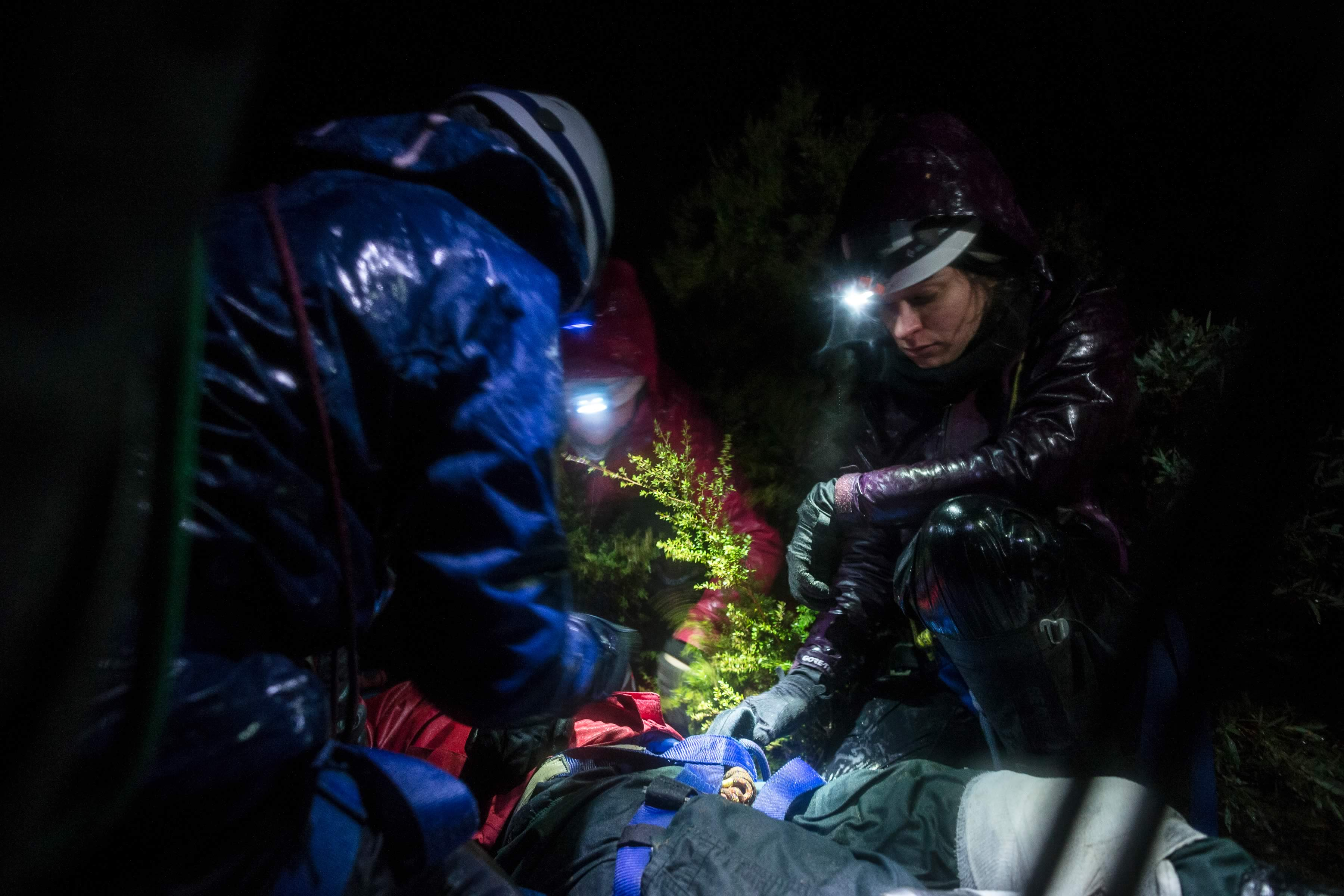 Expeditioners medical training rescue course in night time bushland setting. Photo: Heath Holden.